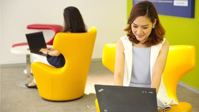Open positions Career, two women working in yellow chairs, one facing the observer the other one can be only seen from behind